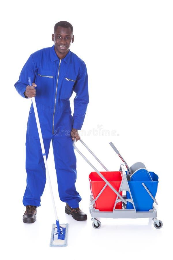 Καθαρότερος καθαρισμός με τη σφουγγαρίστρα στοκ φωτογραφία