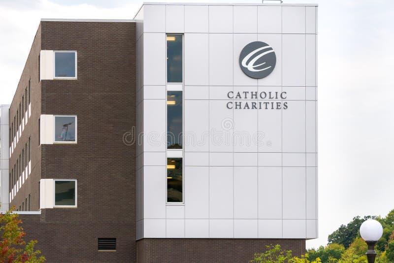 Καθολικό εξωτερικό και λογότυπο φιλανθρωπιών στοκ εικόνα