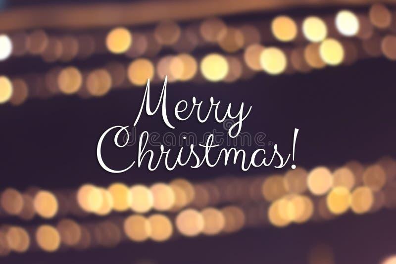 Καλά Χριστούγεννα και χαρούμενη κάρτα για το νέο έτος Θαμπό φόντο έντονου χρυσού στοκ εικόνα με δικαίωμα ελεύθερης χρήσης