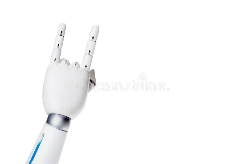 καλλιεργημένος πυροβολισμός του ρομπότ που παρουσιάζει χειρονομία βράχου ελεύθερη απεικόνιση δικαιώματος