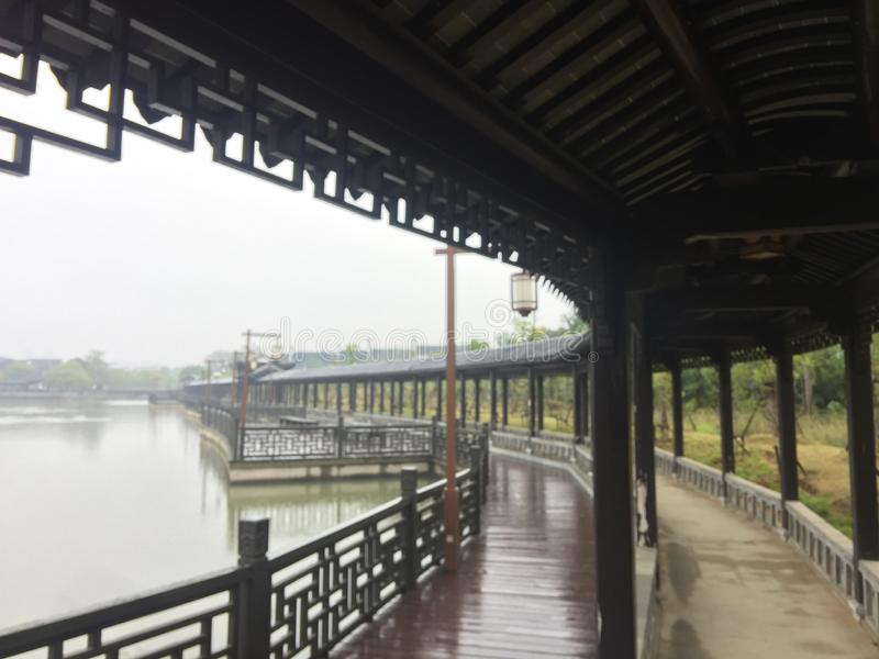 Καλυμμένη γέφυρα - κήπος Jiangnan στοκ εικόνα