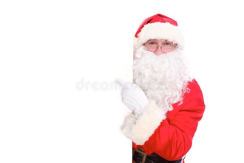 Καλός Άγιος Βασίλης που δείχνει στο άσπρο κενό σημάδι, που απομονώνεται στο άσπρο υπόβαθρο στοκ φωτογραφία με δικαίωμα ελεύθερης χρήσης