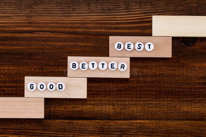 Καλός - καλύτερα - καλύτερος στο ξύλινο υπόβαθρο στοκ φωτογραφία με δικαίωμα ελεύθερης χρήσης