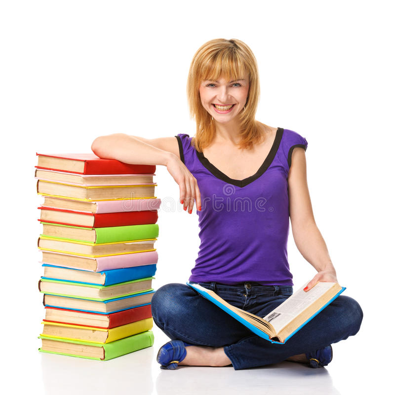 Καλός σπουδαστής με μια στοίβα των βιβλίων στοκ φωτογραφία με δικαίωμα ελεύθερης χρήσης