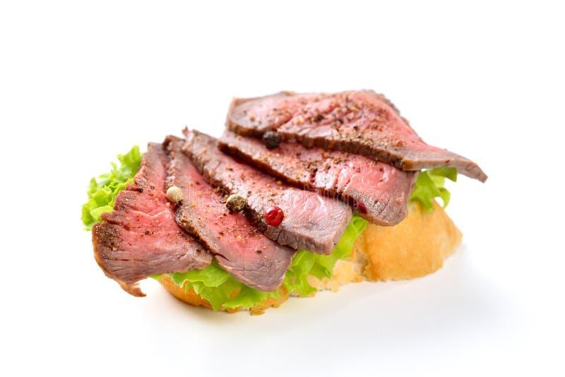 Καναπεδάκια με το βόειο κρέας στοκ εικόνα