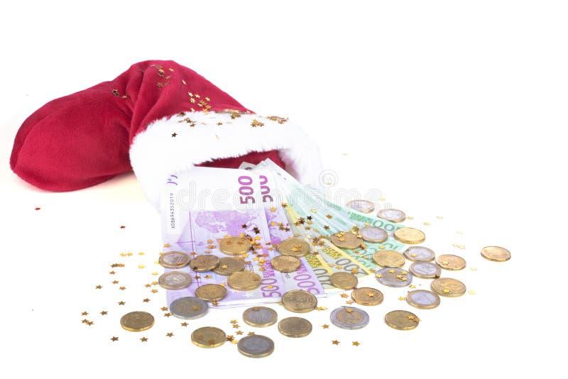 Καπέλο Santa με τα ευρο- χρήματα στοκ εικόνα