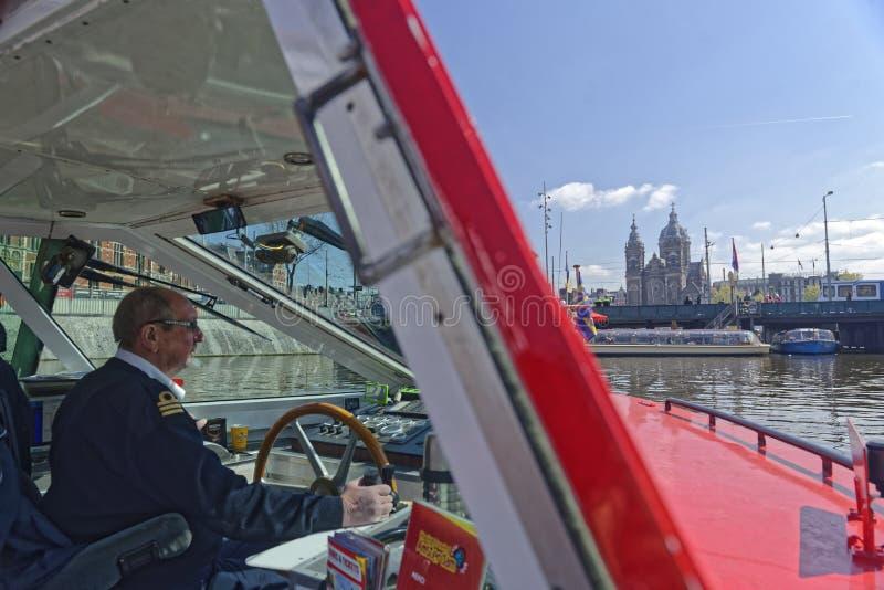 Καπετάνιος της επίσκεψης της βάρκας, Άμστερνταμ, Ολλανδία στοκ εικόνα με δικαίωμα ελεύθερης χρήσης