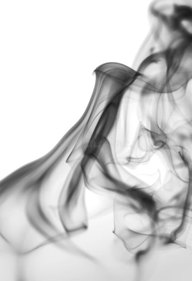 Καπνός στην άσπρη ανασκόπηση στοκ εικόνα