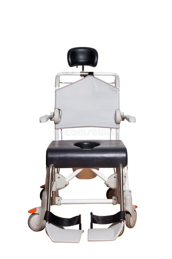 Καρέκλα κομό για παλαιότερο Αναπηρική καρέκλα με το καλάθι τουαλετών για για το με ειδικές ανάγκες άτομο στοκ εικόνες
