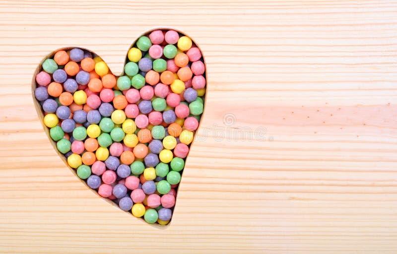 Καραμέλες βαλεντίνων και σύμβολο καρδιών στοκ εικόνες