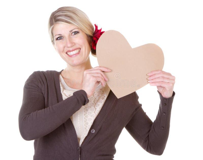 Καρδιά εκμετάλλευσης γυναικών στοκ εικόνα