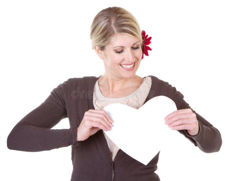 Καρδιά εκμετάλλευσης γυναικών στοκ εικόνα με δικαίωμα ελεύθερης χρήσης