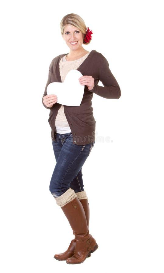 Καρδιά εκμετάλλευσης γυναικών στοκ φωτογραφία με δικαίωμα ελεύθερης χρήσης