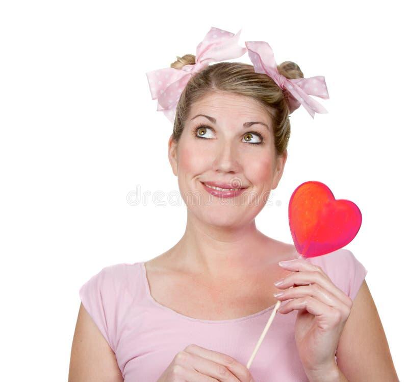 καρδιά που κρατά την ανόητη γυναίκα στοκ εικόνες