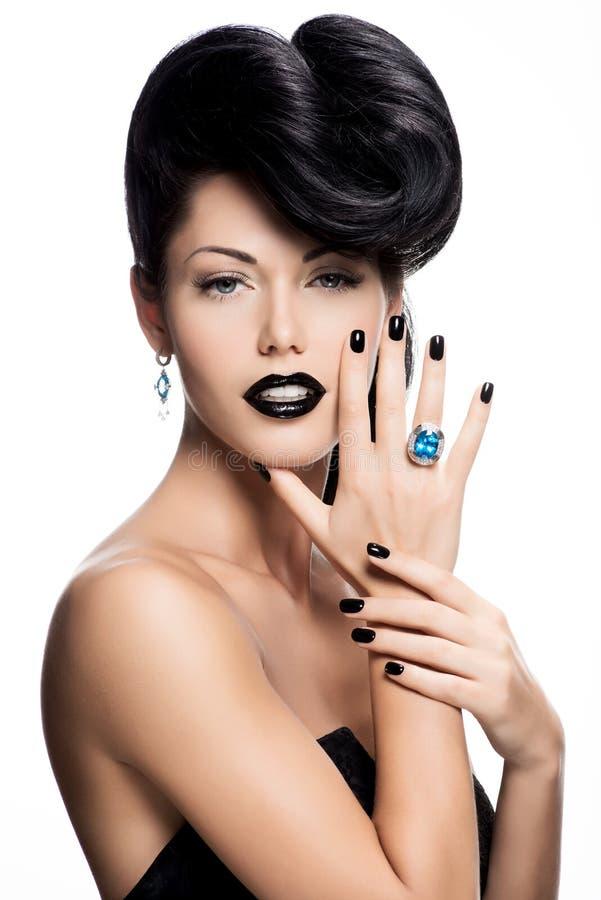 Καρφιά της γυναίκας γοητείας, χείλια και χρωματισμένος ο μάτια Μαύρος χρώματος. στοκ φωτογραφίες