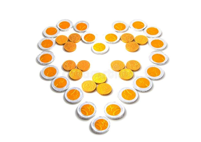 Καρδιά με τα νομίσματα στοκ εικόνες με δικαίωμα ελεύθερης χρήσης