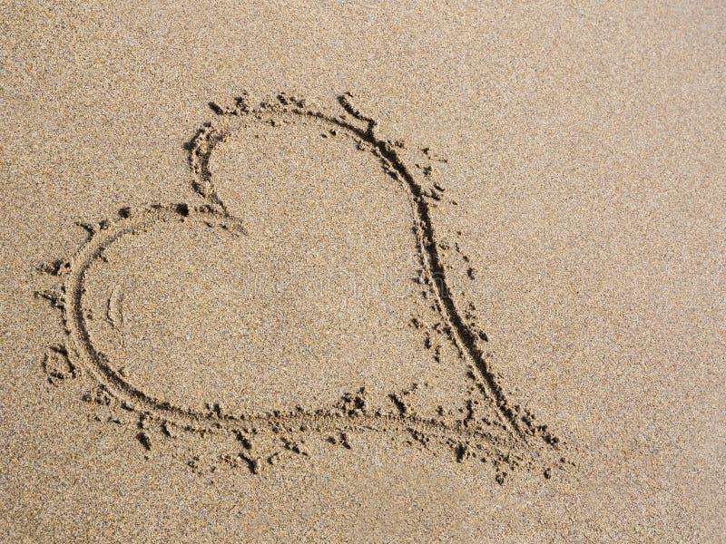 Καρδιά στην άμμο στοκ εικόνα