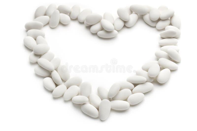 Καρδιά των γλυκαμένων αμυγδάλων στοκ φωτογραφία
