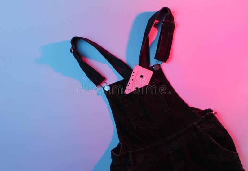 Κασέτα ήχου στην τσέπη velveteen των φορμών στοκ εικόνα με δικαίωμα ελεύθερης χρήσης