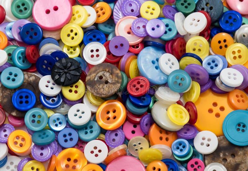 Κατάταξη του χρωματισμένου υποβάθρου κουμπιών στοκ φωτογραφία