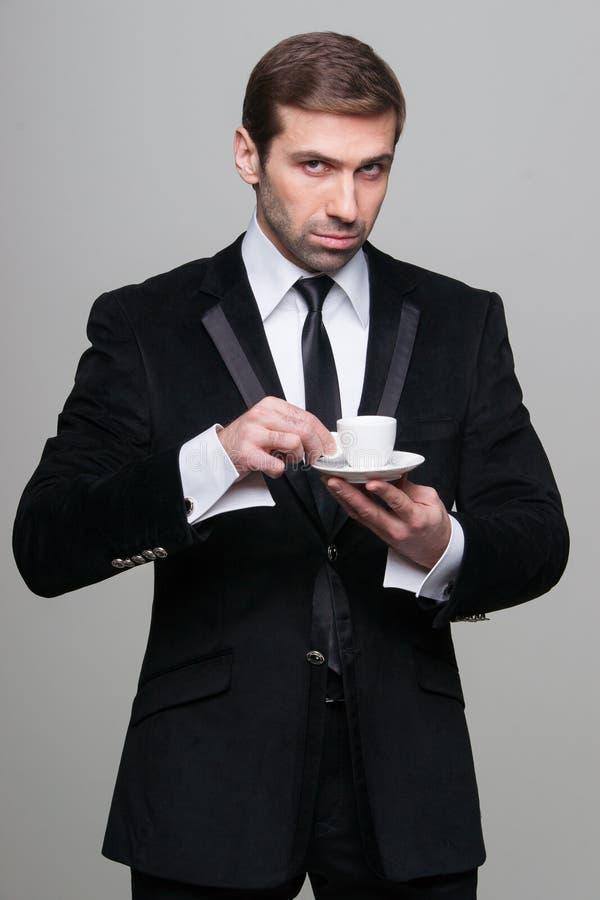 κατανάλωση καφέ επιχειρη στοκ εικόνες