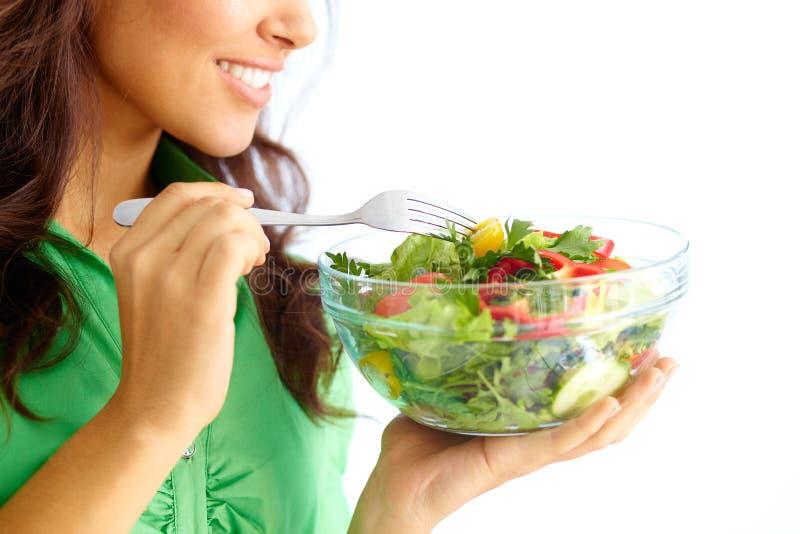 Κατανάλωση της σαλάτας στοκ φωτογραφίες