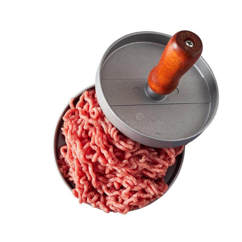 Κατασκευή από κυκλικό μέταλλο με λαβή και ωμό βόειο κρέας στοκ εικόνες