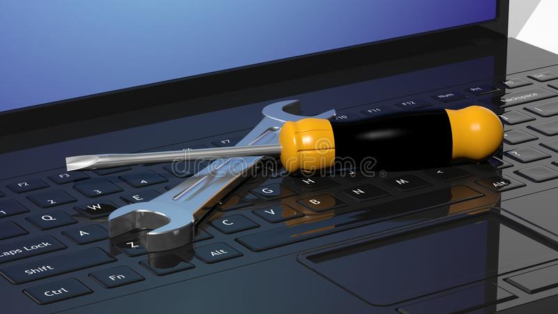 Κατσαβίδι και γαλλικό κλειδί στα lap-top ελεύθερη απεικόνιση δικαιώματος
