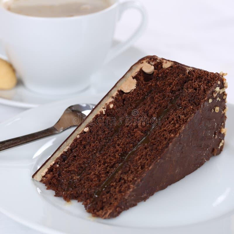 Καυτός φρέσκος καφές και γλυκό επιδόρπιο σοκολάτας κέικ ξινό στοκ εικόνες