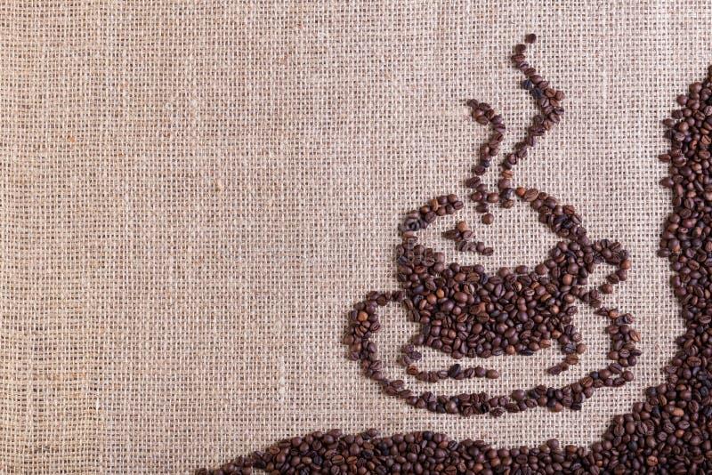 Καφές burlap στο υπόβαθρο σάκων στοκ φωτογραφία με δικαίωμα ελεύθερης χρήσης