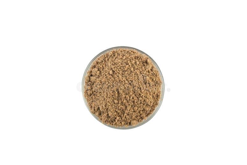 Καφετί αλεύρι καρύδων σε ένα κύπελλο στοκ εικόνα με δικαίωμα ελεύθερης χρήσης