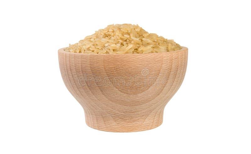 Καφετί ρύζι στο ξύλινο κύπελλο που απομονώνεται στο άσπρο υπόβαθρο διατροφή συστατικό τροφίμων r στοκ φωτογραφία με δικαίωμα ελεύθερης χρήσης