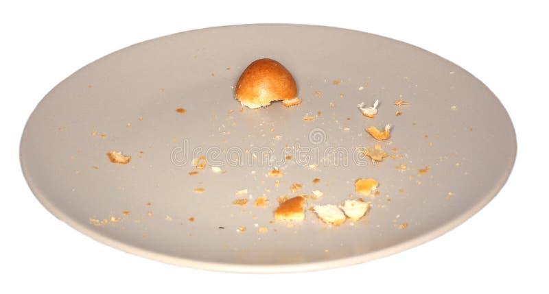 Καφετιά πιάτο και crumbs στοκ εικόνες