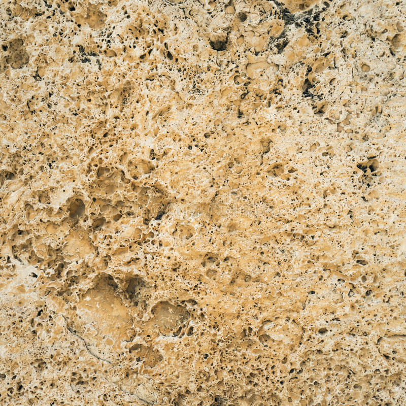Καφετιά σύσταση γρανίτη Φυσικός τραχύς μη επεξεργασμένος και unpolished τοίχος πετρών με την επιφάνεια σιταριού στοκ εικόνες