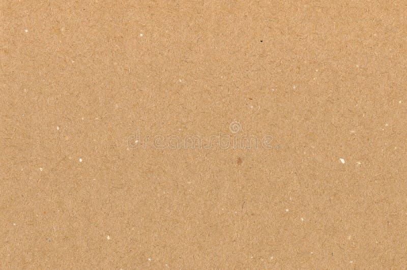 Καφετιά σύσταση χαρτονιού εγγράφου τυλίγματος, φυσικό τραχύ κατασκευασμένο διαστημικό υπόβαθρο αντιγράφων, ελαφρύ μαύρισμα, κίτρι στοκ εικόνες με δικαίωμα ελεύθερης χρήσης