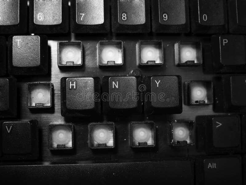 Καλή χρονιά που συλλαβίζουν στο μαύρο κλειδί πληκτρολογίων στοκ εικόνα
