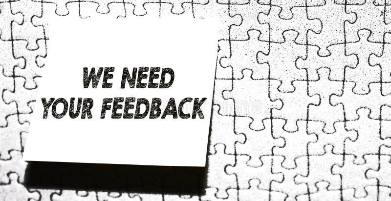 Κείμενο γραψίματος λέξης χρειαζόμαστε την ανατροφοδότησή σας Η επιχειρησιακή έννοια για την κριτική που δίνεται για να πει μπορεί στοκ εικόνα