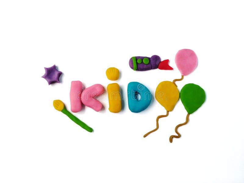 Κείμενο παιδιών, άργιλος plasticine, πύραυλος μπαλονιών διακοσμήσεων και πινέλο στοκ εικόνα με δικαίωμα ελεύθερης χρήσης