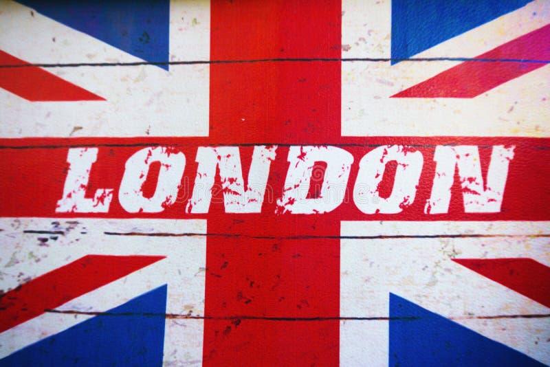 Κείμενο του Λονδίνου στην παλαιά σχεδιασμένη grunge βρετανική σημαία στοκ εικόνες με δικαίωμα ελεύθερης χρήσης