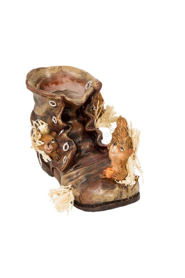 Κενά παπούτσια δοχείων με το σκίουρο στοκ εικόνες