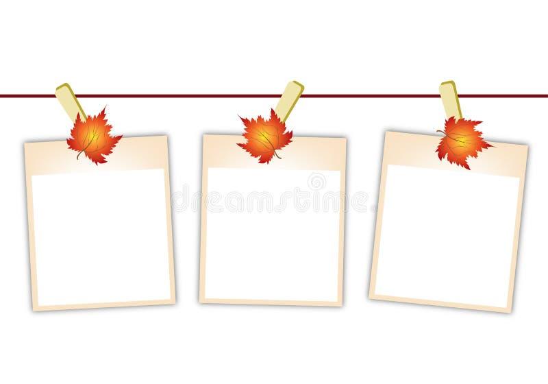 Κενές φωτογραφίες με τα φύλλα σφενδάμου που κρεμούν σε Clothesl απεικόνιση αποθεμάτων