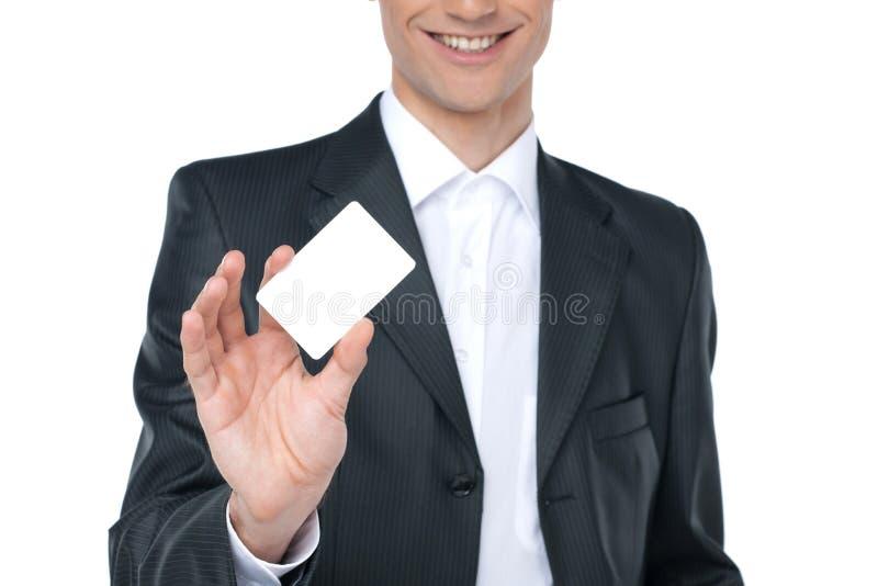 Κενή επαγγελματική κάρτα σε ένα χέρι στοκ φωτογραφίες