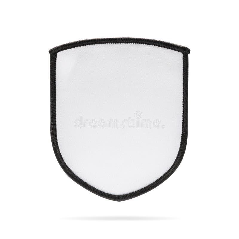 Κενή ετικέτα μπαλωμάτων ή υφάσματος στο απομονωμένο υπόβαθρο με το ψαλίδισμα της πορείας Λευκό ομάδα ή έμβλημα λογότυπων για το m στοκ εικόνα με δικαίωμα ελεύθερης χρήσης