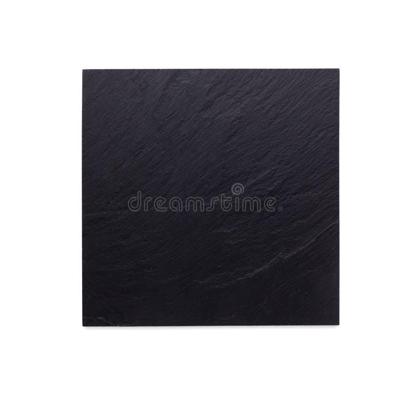 Κενό αγροτικό μαύρο πιάτο πετρών πλακών που απομονώνεται στο άσπρο υπόβαθρο στοκ εικόνα με δικαίωμα ελεύθερης χρήσης