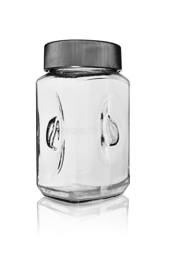 Κενό βάζο για το στιγμιαίο καφέ από μια πλαστική κάλυψη που κλείνει Σε ένα άσπρο υπόβαθρο με την αντανάκλαση στοκ εικόνα