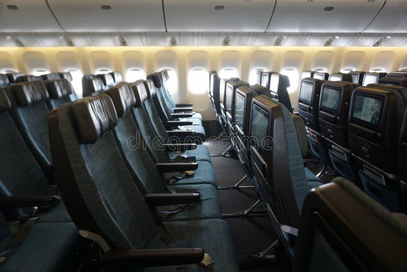 Κενό κάθισμα καμπινών αεροπλάνων με το πράσινο uphostery στοκ φωτογραφία με δικαίωμα ελεύθερης χρήσης