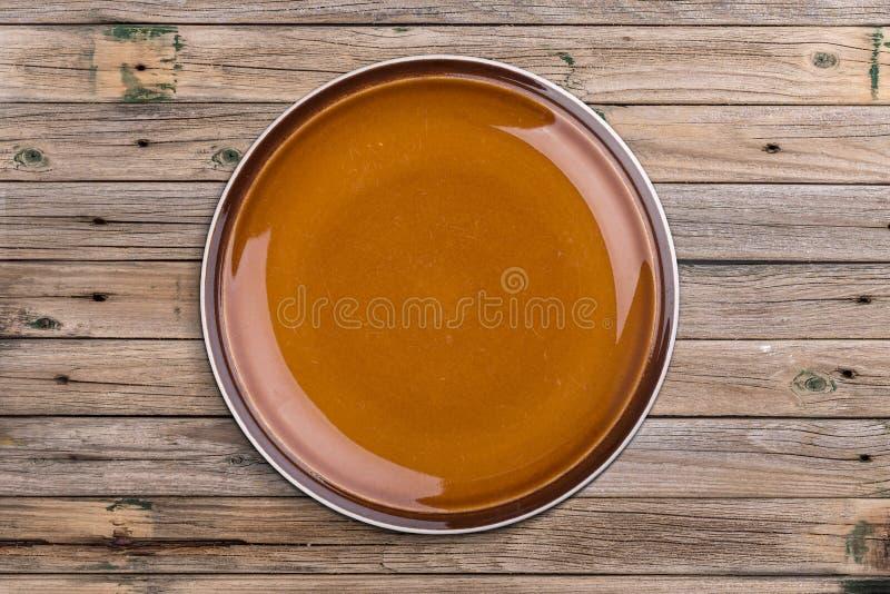 Κενό καφετί πιάτο στοκ φωτογραφίες