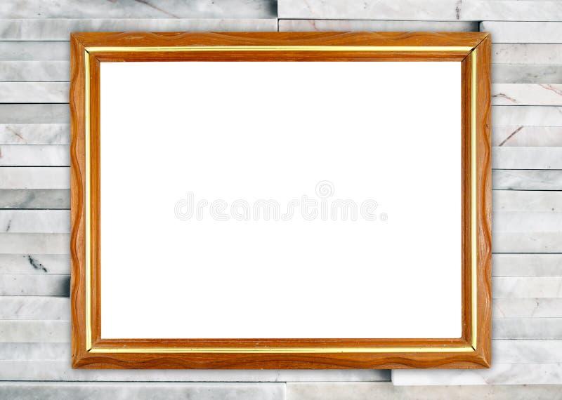 Κενό ξύλινο πλαίσιο στο σύγχρονο μαρμάρινο τοίχο στοκ φωτογραφίες