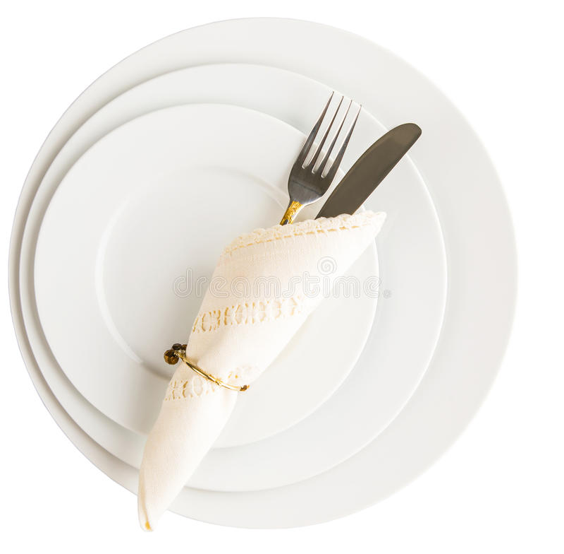Κενό πιάτο, δίκρανο, μαχαίρι, πετσέτα στοκ εικόνες