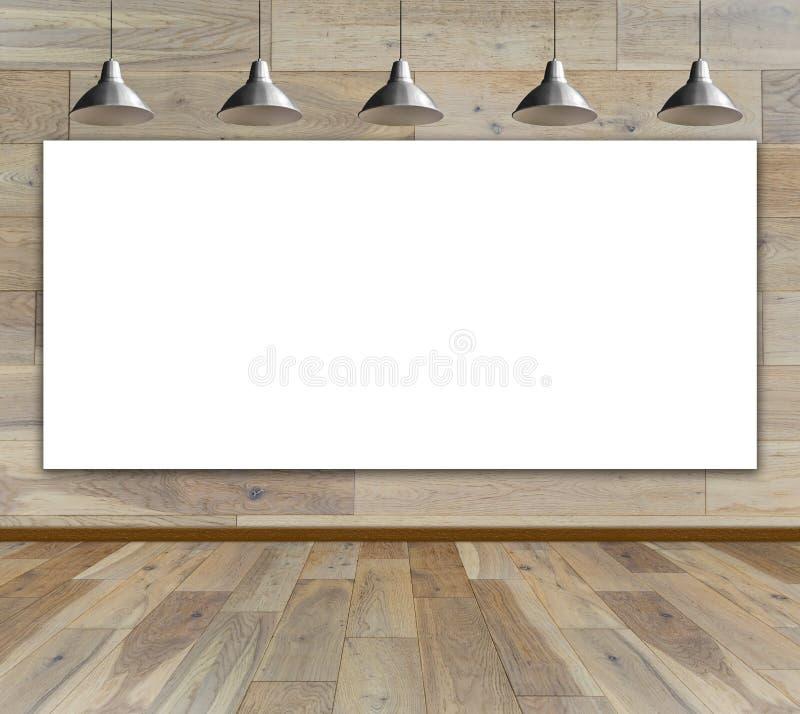 Κενό πλαίσιο στο ξύλινο δωμάτιο με τον ανώτατο λαμπτήρα στοκ εικόνες